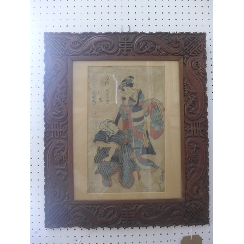 61 - An early 20th Century Japanese coloured print of two figures, in a carved frame decorated with drago...
