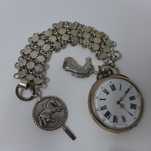 1036 - A silver open face pocket watch, 1870, white enamel dial with Roman and Arabic numerals, ornate gilt...