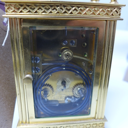 1054 - A late 19th century French brass repeating carriage clock, the convex enamel dial with Arabic numera...