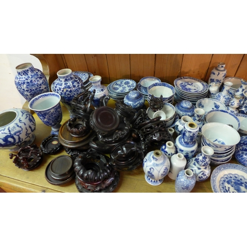 36 - An extensive collection of Chinese blue and white porcelain, to include stands and variety of vases ...