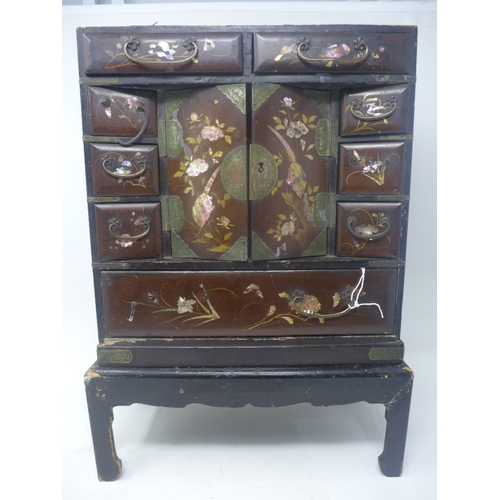 6 - A late 19th century Japanese cabinet with abolone inlay, H.43cm W.29cm...