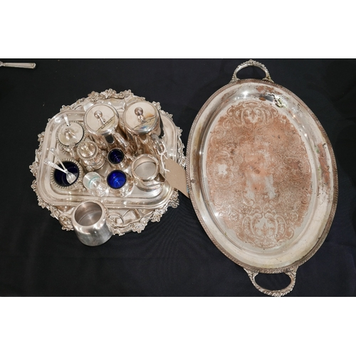 14 - A collection of silver-plated items to include trays, a salver, salt cellars with blue glass linings...