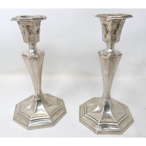16 - A collection of silver items to include a pair of filled, silver candlesticks H: 18 cm, a silver top...