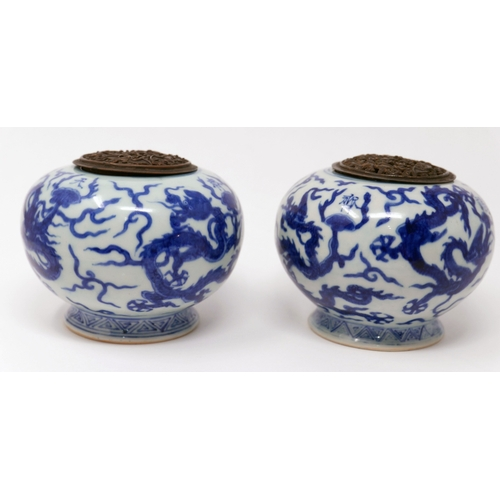 1000 - A pair of late 18th / early 19th century Chinese blue and white porcelain incense burners, decorated...