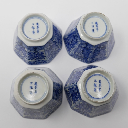 1007 - A set of four Chinese Kangxi period blue and white octagonal cups, floral design, H.6 W.7 D.7cm...
