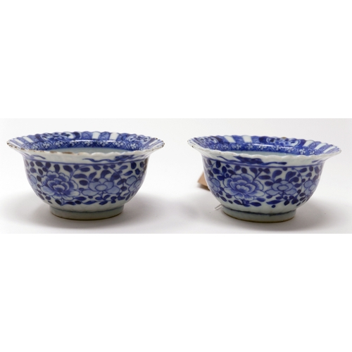 1008 - A pair of Chinese Kangxi period blue and white cups, figural and floral design, H.4cm Diameter 9cm...