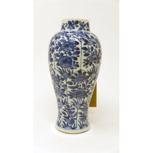 1011 - A Chinese Kangxi period blue and white vase, floral decoration, H.18cm (hairline crack)...