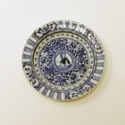 1021 - An 18th century Chinese blue and white scalloped dish, central figural design within floral border, ...
