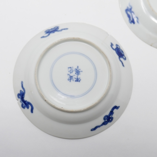 1024 - Three Chinese Kangxi period blue and white dishes, figural design, Diameter 10cm (one restored, one ...