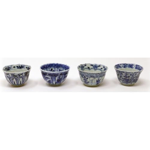 1030 - Four Chinese Kangxi period blue and white cups, figural designs...