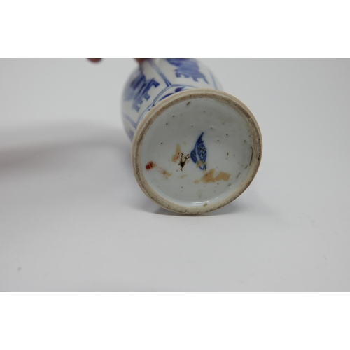 1031 - A Chinese Kangxi period blue and white vase, floral panel design, H.18cm (rim restored)...