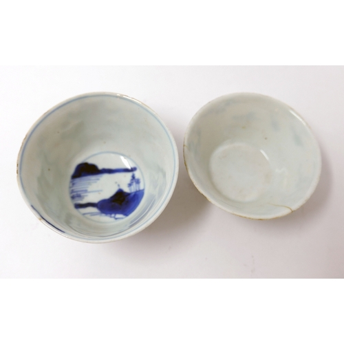 1036 - An 18th century Chinese blue and white cup, pagoda design, together with one other...