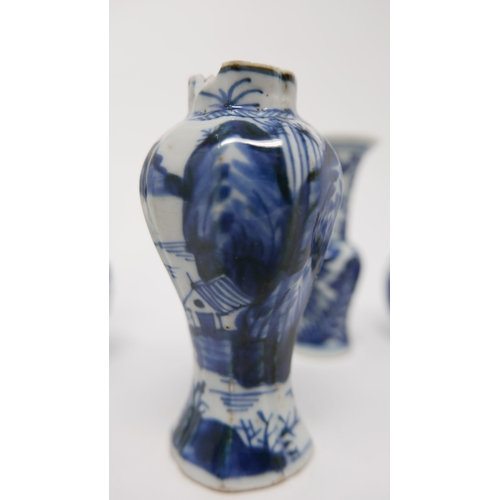 1038 - Five 18th century Chinese blue and white miniature vases (damaged)...