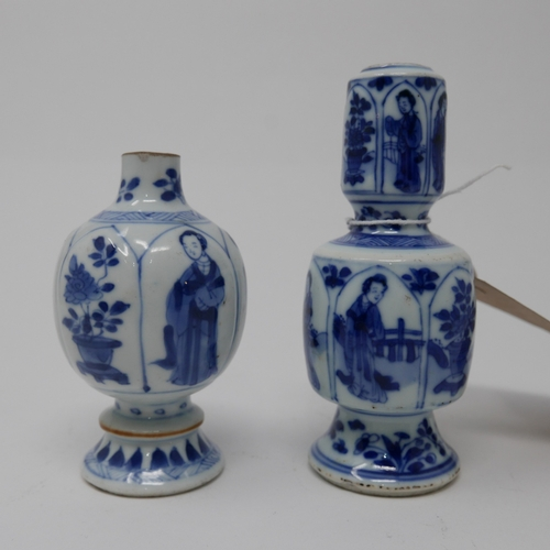1041 - Two Chinese Kangxi period blue and white vases, figural design, tops cut down, tallest H.12cm...