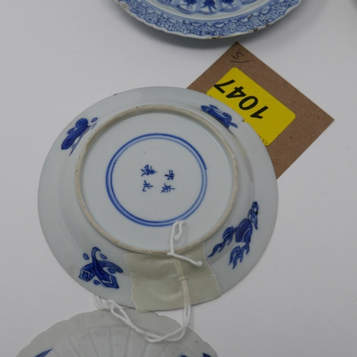 1047 - Five 18th century Chinese blue and white dishes, floral and figural design...