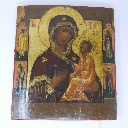 25 - A Russian icon, the Mother of God of Smolensk, flanked by an angel and three selected saints to poly...