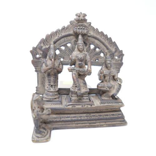 44 - A 19th century bronze Hindu altar piece, depicting three three deities on a shrine with floral desig...