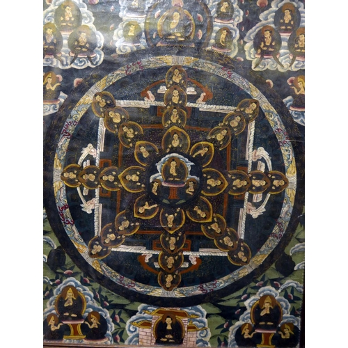 58 - A late 19th century Tibetan mandala thangka, depicting numerous deities, hand painted on linen, fram...