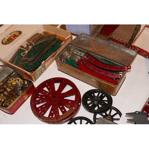 46 - A large and extensive collection of 1920's  Meccano, with clockwork motors, a collection of building...