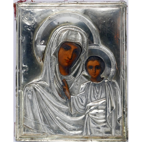19 - A Russian icon, Mother of God of Kazan, with silver oklad, bears hallmarks, 23 x 18cm...