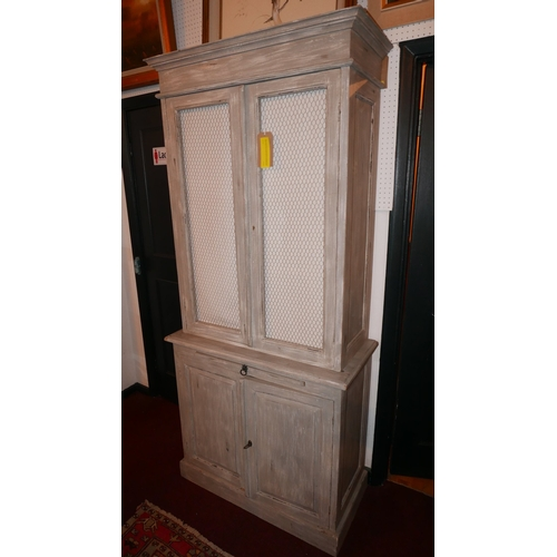 1021 - A 20th century French grey painted and distressed kitchen cabinet, with two mesh panelled doors over...