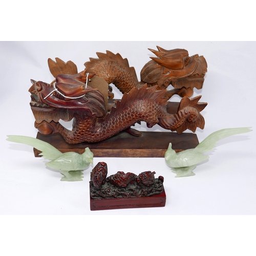 10 - A pair of Chinese jade birds together with two wooden dragons and a resin fish ornament...