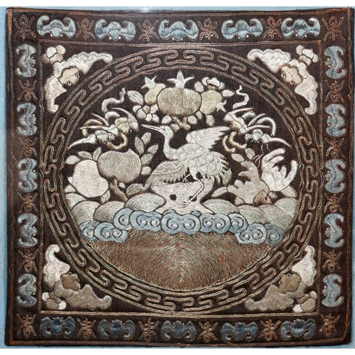 14 - A 19th century Chinese silk embroidery depicting cranes, bats and stylised flowers, framed and glaze...