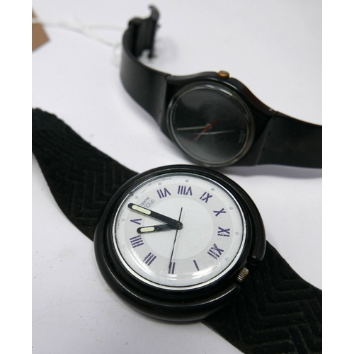 42 - Two Swatch watches, to include a black Swatch with vortex design dial marked AG 1986, and a Pop Swat...