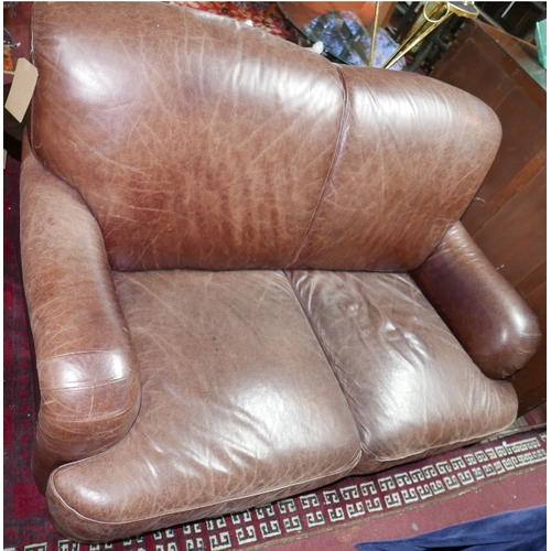 218 - A contemporary brown leather two seater sofa...