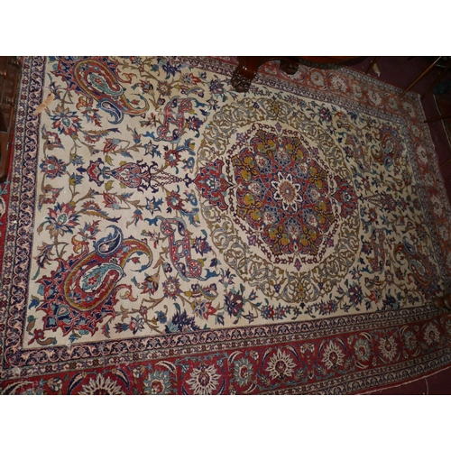 61 - A 20th century Isfahan carpet with central floral medallion on a cream ground, surrounded by floral ...