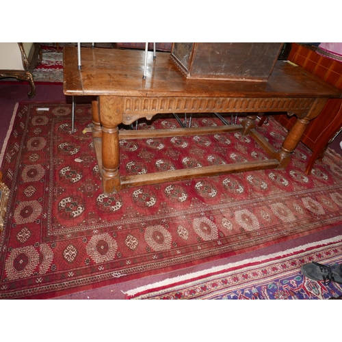 82 - An antique North East Persian Turkoman carpet, repeating stlyised Tekkeh motifs on a terracotta fiel...