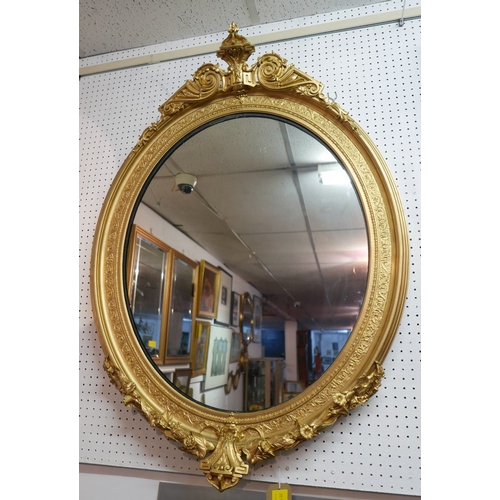 225 - A late 19th/early 20th century neoclassical oval giltwood mirror, 110 x 80cm...