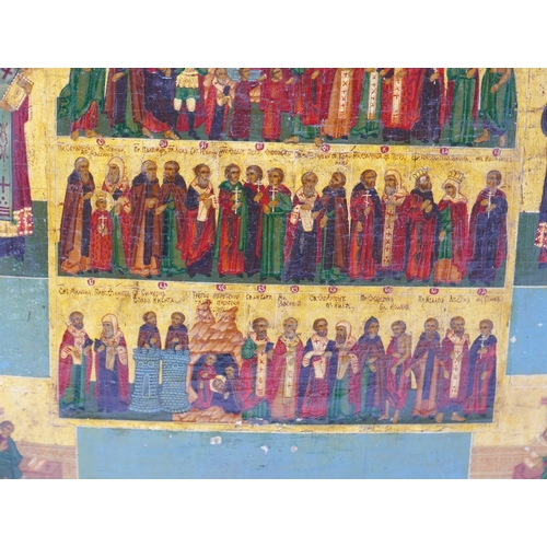 8 - A Russian menological icon depicting selected saints, having religious scenes and saints to border, ...