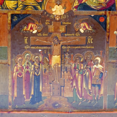 39 - A Russian icon depicting the crucifixion of Christ flanked by angels and saints, with Christ Pantocr...