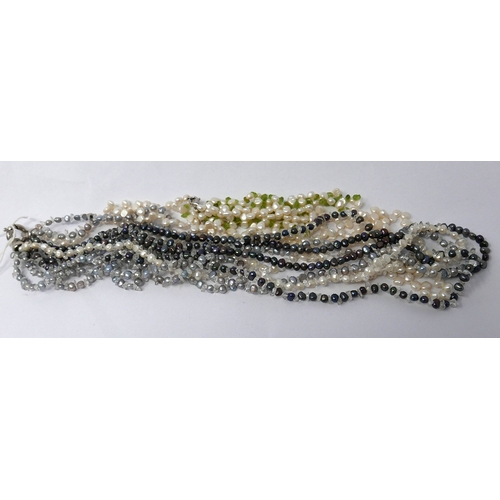198 - Two freshwater pearl strand necklaces to include a long 5-strand grey and white pearl necklace, L.67...