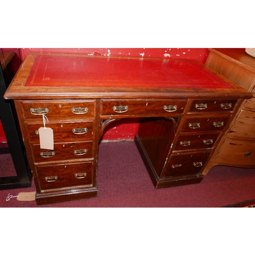 147 - An Arts and Crafts mahogany kneehole desk with nine drawers, one stamped 'Doveston. Davey. Hull & Co...