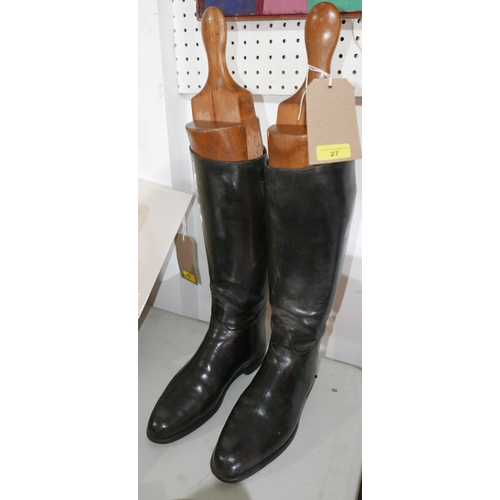 27 - A pair of black leather riding boots, together with boot trees, H.44cm (boots)...