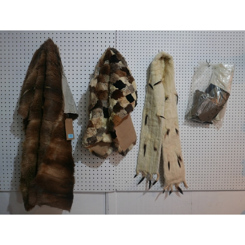 119 - A vintage ermine fur stole together with two fur cut offs, 4 pairs of vintage gloves and some spats...