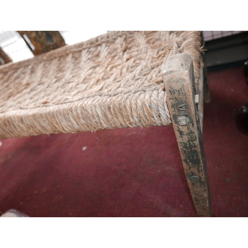 309 - A late 19th Century French rustic daybed with woven rush seat on a simple timber frame, H.60cm L.155...