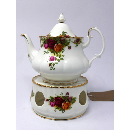 266 - A Royal Albert bone china teapot and matching teapot stand in the Country Roses pattern, with gilded...