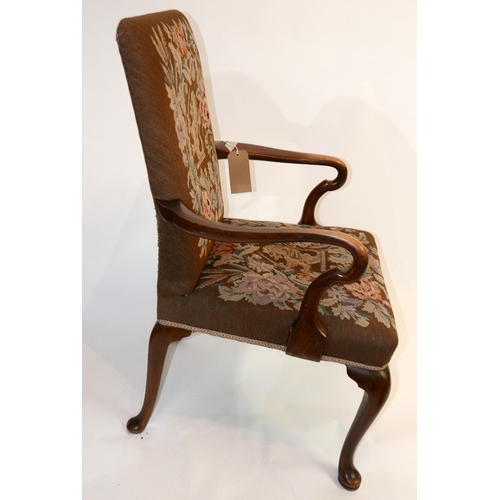 135 - A Victorian needlepoint elbow armchair with walnut arm rests and cabriole legs...