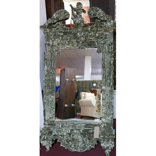 138 - A large Squint Limited neo classical style mirror, the broken swan neck pediment with central putti,...