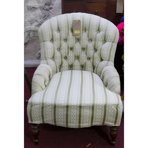 172 - A late 19th century mahogany button-back chair with turned legs and cream and green striped upholste...