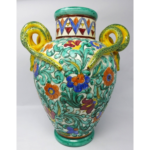 174 - A Majolica style ceramic vase with snake handles, signed to base, H.37cm...