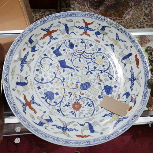 336 - A large Chinese dish, decorated with phoenixes amongst stylised flowers and cranes amongst stylised ...
