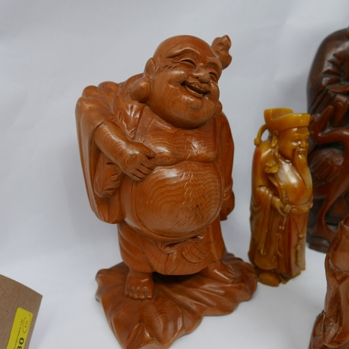 80 - A carved wooden Buddha figure, 6 others similar and 3 similar resin figures H 29cm...