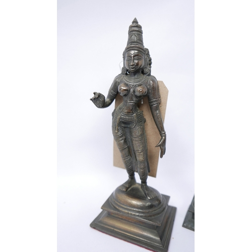 87 - A figure of a Hindu goddess and 5 similar smaller figures H 23cm...