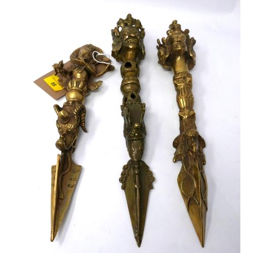 88 - A set of 3 bronze Tibetan Phurbas with incised decoration 34cm...