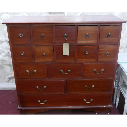 99 - A large hardwood chest of drawers with a variety of storage drawers - 16 in total, 106 x 109 x 39cm...