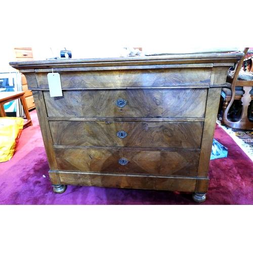 100 - A 19th century biedermeier walnut commode with four drawers, raised on bun feet, H.87 W.111 D.58cm...